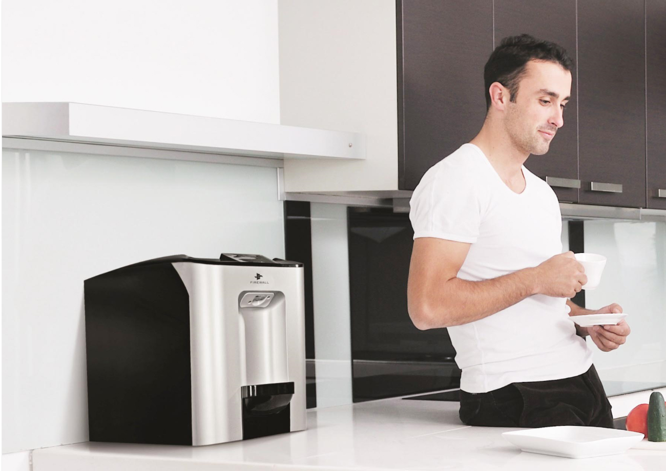 man and cube water dispenser in kitchen counter